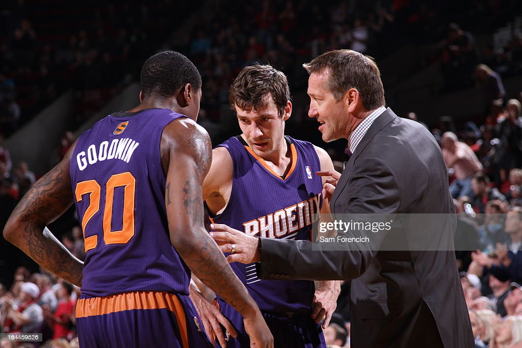 Jeff Hornacek talks to Archie Goodwin #20 of the Phoenix Suns during the game against the Portland Trail Blazers on October 9, 2013 at the Moda Center Arena in Portland, Oregon.