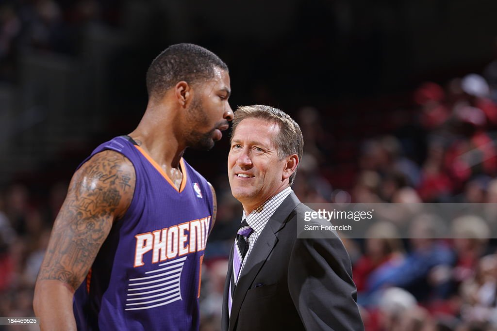 Jeff Hornacek talks to Markieff Morris #11 of the Phoenix Suns during the game against the Portland Trail Blazers on October 9, 2013 at the Moda Center Arena in Portland, Oregon.