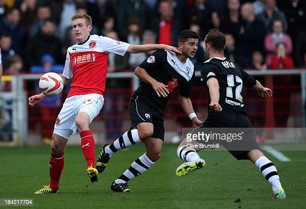 Jeff Hughes of Fleetwood Town in action with Sam Morsy of Chesterfield during the Sky Bet League Two match between Fleetwood Town and Chesterfield at...