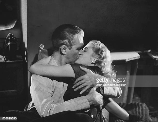 Jeff Jeffries and Lisa Carol Fremont kissing in the 1954 Hitchcock suspense film Rear Window