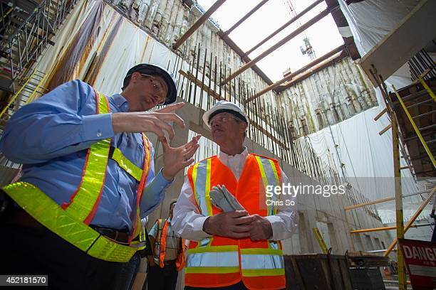 Jeff Joss project coordinator for the Toronto Port Authority island tunnel project explains the construction progress to Minister of Finance Joe...