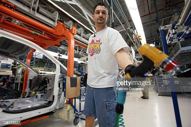Jeff Kartye installs trim for a Chrysler Minivan on the assembly line at the Chrysler Windsor Assembly plant January 18 2011 in Windsor Ontario...