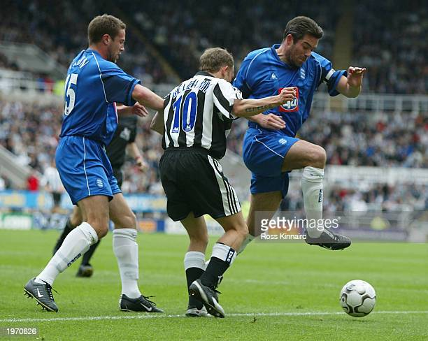 Jeff Kenna of Birmingham is challenged by Craig Bellamy of Newcastle during the FA Barclaycard Premiership match between Newcastle United and...