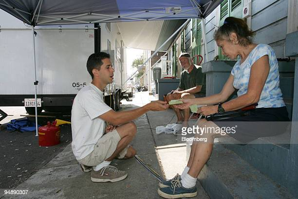 Jeff Kennedy a paramedic with BiCounty Ambulance Service of Yuba City California talks with New Orleans resident Altair Gable about her tetanus and...