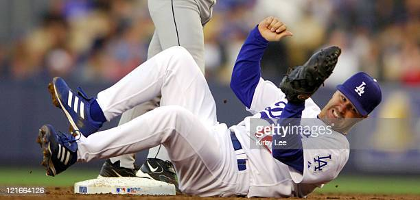 Jeff Kent of the Los Angeles Dodgers falls backward after tagging out Ivan Rodriguez at second base in the second inning of 84 loss at Dodger Stadium...