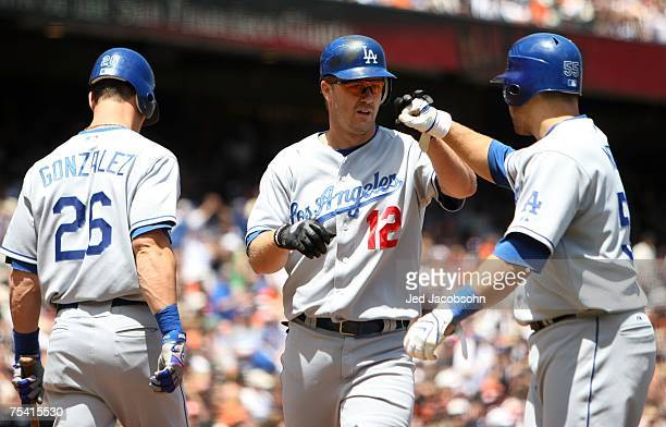 Jeff Kent of the Los Angeles Dodgers is congratulated by Russell Martin after hitting a three run home run against the San Francisco Giants at ATT...