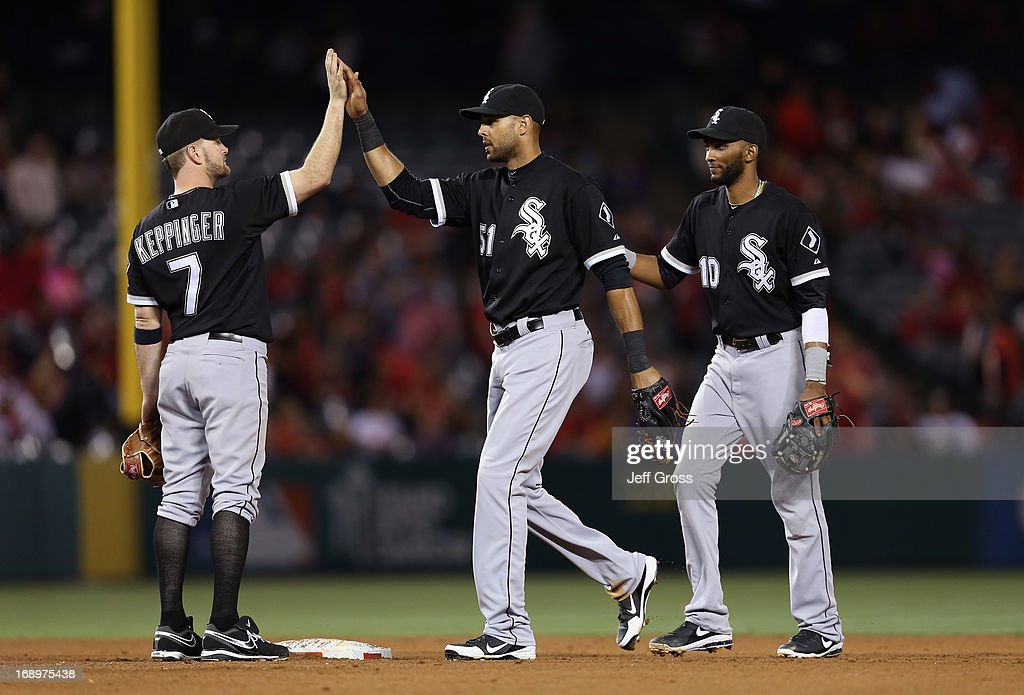 Jeff Keppinger #7, Alex Rios #51 and Alexei Ramirez #10 of the Chicago White Sox celebrate their teams 3-0 victory over the Los Angeles Angels of Anaheim at Angel Stadium of Anaheim on May 17, 2013 in Anaheim, California.