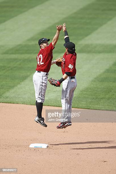 Jeff Keppinger and Kazuo Matsui of the Houston Astros celebrate the Astros first victory of the season during the game between the Houston Astros and...