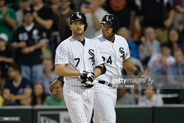 Jeff Keppinger of the Chicago White Sox and teammate Dayan Viciedo walk back to the dugout after Keppinger hit a tworun home run scoring Viciedo...