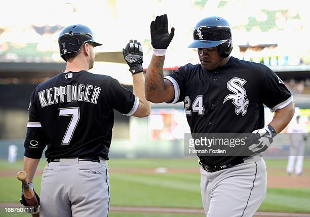 Jeff Keppinger of the Chicago White Sox congratulates teammate Dayan Viciedo on a solo home run against the Minnesota Twins during the second inning...