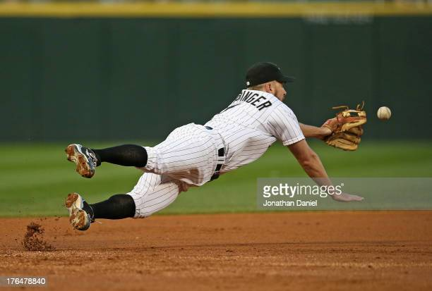 Jeff Keppinger of the Chicago White Sox dives in vain for a ball hit by Brayan Pena of the Detroit Tigers in the 2nd inning at US Cellular Field on...