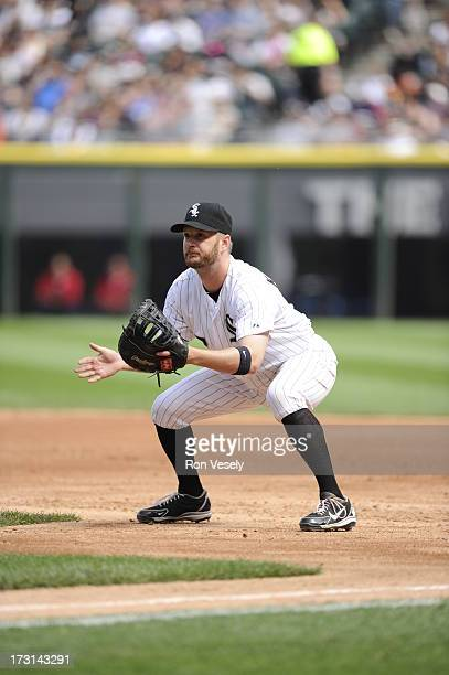 Jeff Keppinger of the Chicago White Sox fields against the Cleveland Indians on June 29 2013 at US Cellular Field in Chicago Illinois