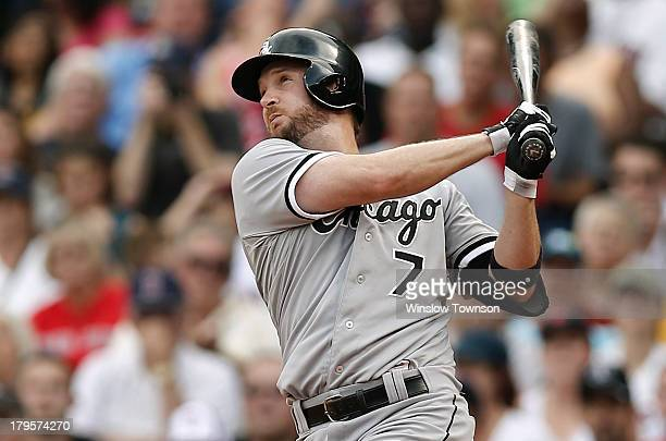 Jeff Keppinger of the Chicago White Sox follows through against the Boston Red Sox during the fourth inning at Fenway Park on September 1 2013 in...
