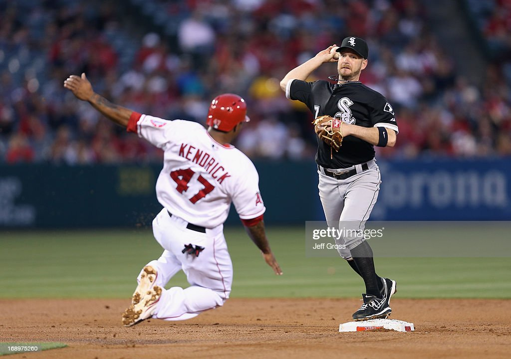 Jeff Keppinger #7 of the Chicago White Sox forces Howie Kendrick #47 of the Los Angeles Angels of Anaheim out at second base before throwing to first to complete the double play in the second inning at Angel Stadium of Anaheim on May 17, 2013 in Anaheim, California.