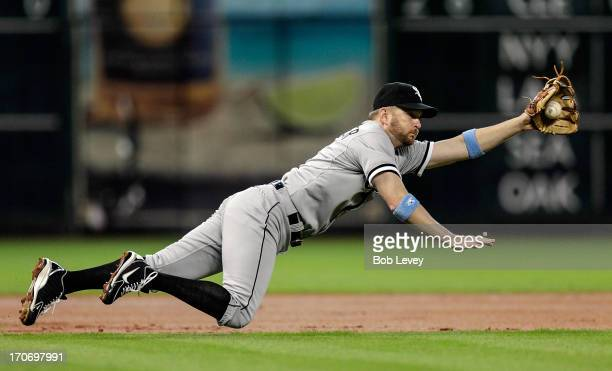 Jeff Keppinger of the Chicago White Sox makes a diving stop on a ball hit by Brandon Barnes of the Houston Astros in the first inning at Minute Maid...