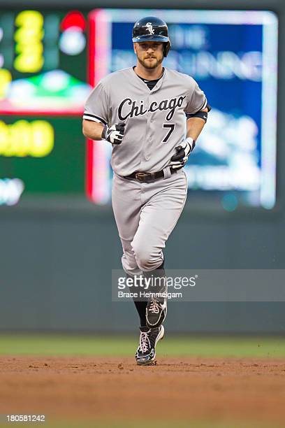 Jeff Keppinger of the Chicago White Sox rounds the bases after hitting a home run against the Minnesota Twins on August 16 2013 at Target Field in...