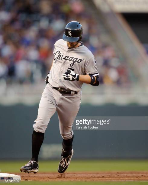 Jeff Keppinger of the Chicago White Sox rounds the bases after he hit a home run against the Minnesota Twins on August 16 2013 at Target Field in...