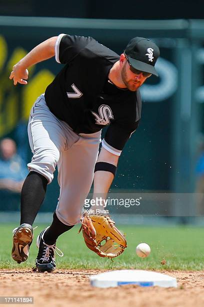 Jeff Keppinger of the Chicago White Sox scoops up a bouncing ball and attempts to throw out Eric Hosmer of the Kansas City Royals fourth inning on...
