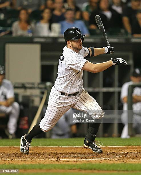 Jeff Keppinger of the Chicago White Sox singles in the 8th inning against the Detroit Tigers at US Cellular Field on August 12 2013 in Chicago...