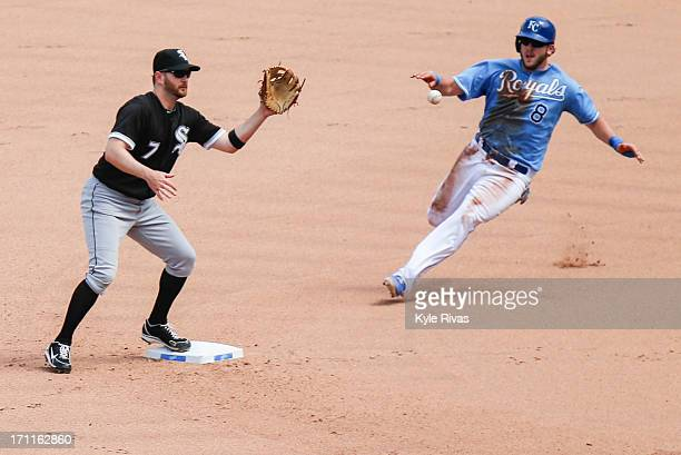 Jeff Keppinger of the Chicago White Sox tags out Mike Moustakas of the Kansas City Royals at second in the seventh inning on June 22 2013 at Kauffman...