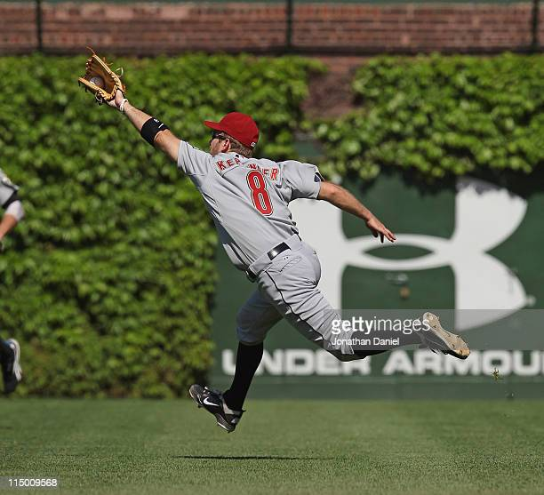 Jeff Keppinger of the Houston Astros catches a pop fly against the Chicago Cubs at Wrigley Field on June 1 2011 in Chicago Illinois The Astros...