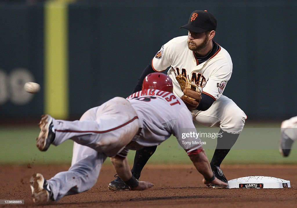 Jeff Keppinger #8 of the San Francisco Giants tags out Willie Bloomquist #18 of the Arizona Diamondbacks on a steal attempt at AT&T Park on September 3, 2011 in San Francisco, California.