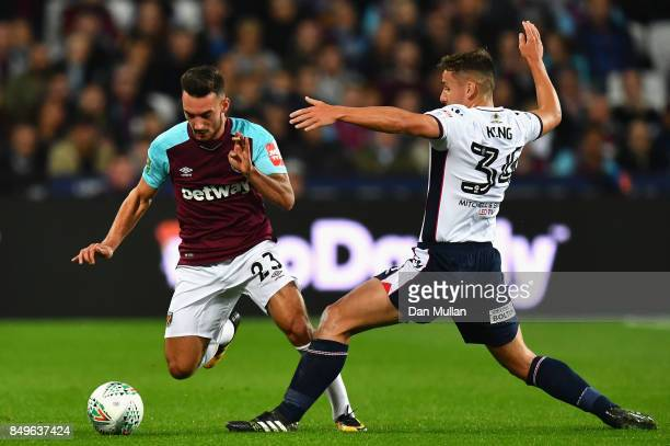 Jeff King of Bolton Wanderers tackles Sead Haksabanovic of West Ham United during the Carabao Cup Third Round match between West Ham United and...