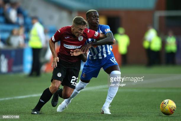 Jeff King of St Mirren battles with Mikael Ndjoli of Kilmarnock FC during the Betfred Scottish League Cup match between Kilmarnock and St Mirren at...