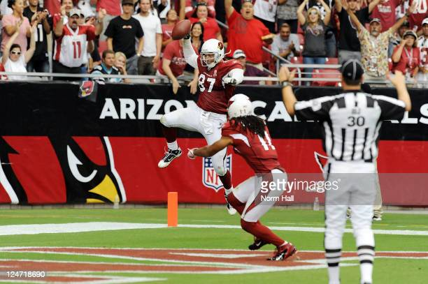 Jeff King of the Arizona Cardinals and teammate Larry Fitzgerald celebrate a touchdown against the Carolina Panthers in the NFL season opening game...