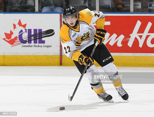 Jeff King of the Sarnia Sting skates with the puck against the London Knights during an OHL game at the Budweiser Gardens on January 24 2014 in...