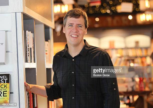Jeff Kinney author of Diary of a Wimpy Kid'' series poses at his new Plainville Mass bookstore An Unlikely Story on July 10 2015