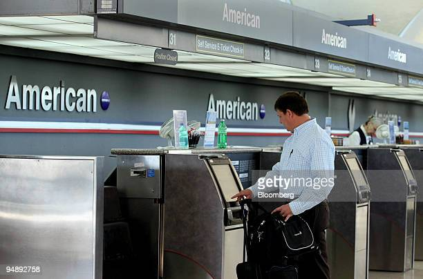Jeff Klenke of Indianapolis Indiana checks in for his American Airlines flight at LambertSt Louis International Airport in St Louis Missouri US on...