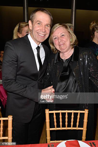 Jeff Koons and Miss Francois Pinault attend the 'Societe des amis du Musee D'Art Moderne' : Annual Dinner. Held at Centre Pompidou on March 11, 2014...