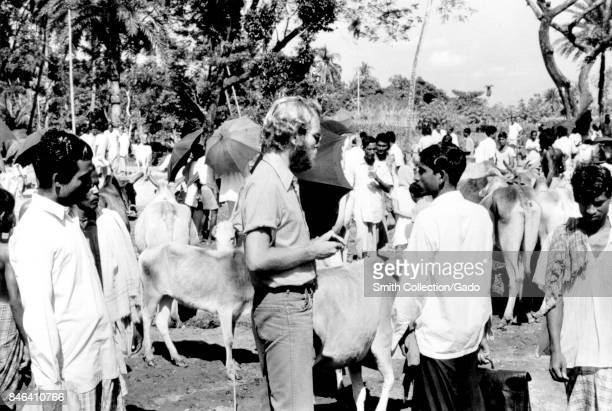 Jeff Koplan MD MPH among a group of native villagers and animals during a smallpox eradication effort in Bangladesh 1970 Image courtesy CDC