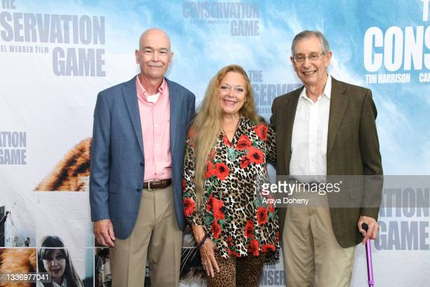 """Jeff Kremer, Carole Baskin and Howard Baskin attend the Los Angeles theatrical premiere of """"The Conservation Game"""" on August 28, 2021 in Santa..."""