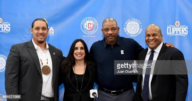 Jeff L Grubbe Gillian Zucker Doc Rivers and Malcom Turner pose for a photo during the Los Angeles Clippers announcement of their acquisition of an...