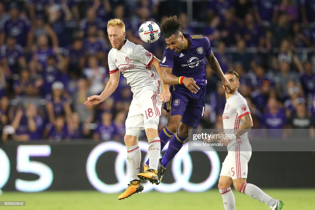 Jeff Larentowicz #18 of Atlanta United and Giles Barnes #14 of Orlando City SC leap for the ball during a MLS soccer match between Atlanta United FC and the Orlando City SC at Orlando City Stadium on July 21, 2017 in Orlando, Florida.