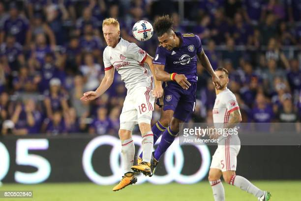 Jeff Larentowicz of Atlanta United and Giles Barnes of Orlando City SC leap for the ball during a MLS soccer match between Atlanta United FC and the...
