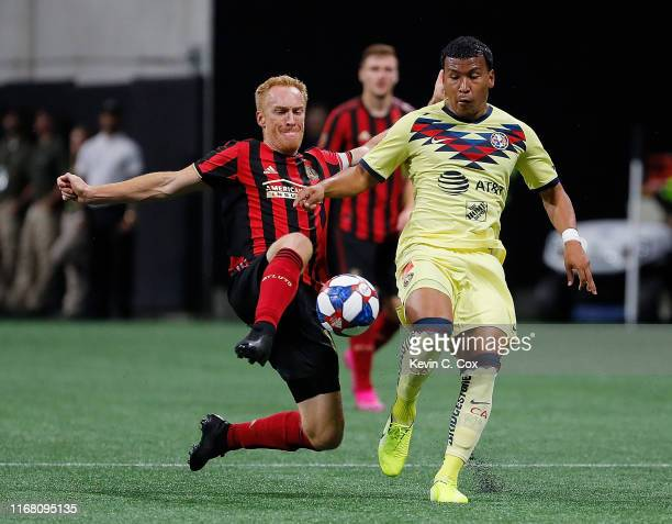 Jeff Larentowicz of Atlanta United challenges Roger Martinez of Club America during the final of the Campeones Cup between Club America and Atlanta...