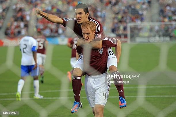 Jeff Larentowicz of the Colorado Rapids celebrates his goal on a penalty shot with Martin Rivero of the Colorado Rapids in the 18th minute to tie the...