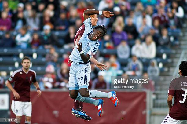 Jeff Larentowicz of the Colorado Rapids gets tangled up with Kei Kamara of Sporting Kansas City as they go up for a head ball during their game at...