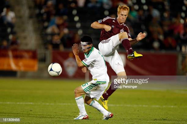 Jeff Larentowicz of the Colorado Rapids turns the ball away from Kosuke Kimura of the Portland Timbers at Dick's Sporting Goods Park on September 5...