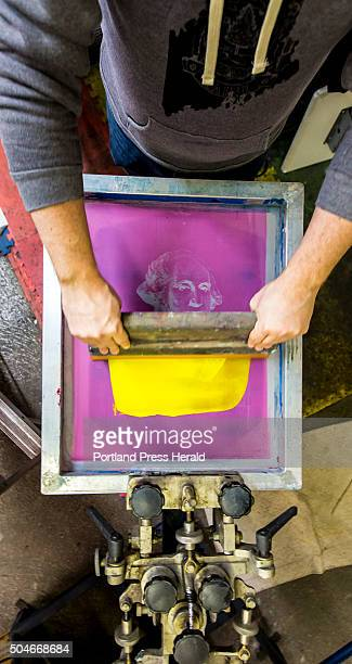 Jeff Lauzier partowner of Loyal Citizen Clothing spreads yellow ink across a silkscreen image of George Washington