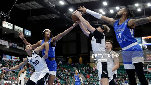 Jeff Ledbetter of the Austin Spurs grabs a rebound against Isaac Copeland of the Texas Legends and Moses Brown of the Texas Legends during the first...