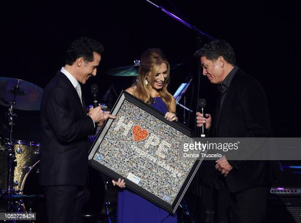 Jeff Leibow and Melody Leibow present Keith Thompson with the Advocate Of Hope award at Las Vegas's 8th annual NF Hope Concert A Benefit for...