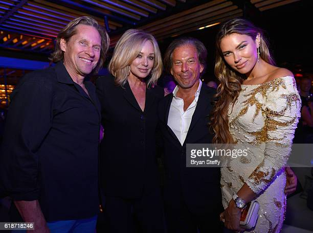 Jeff Lester and his wife actress Susan Anton RH Chairman and CEO Gary Friedman and Bella Hunter attend the unveiling of RH Las Vegas at The Gallery...