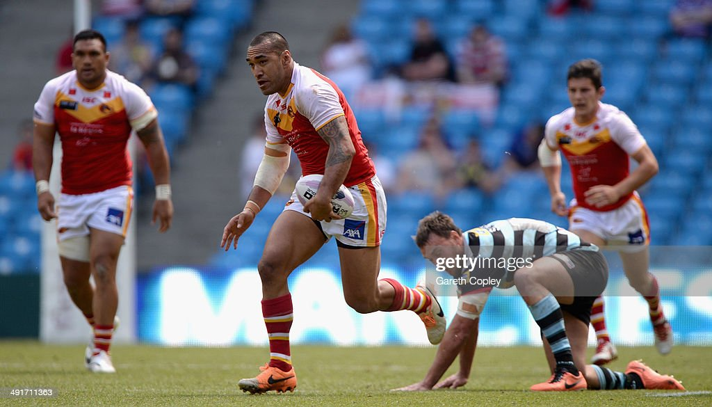 Jeff Lima of Catalan Dragons gets past Nick Slyney of London Broncos during the Super League match between London Broncos and Catalan Dragons at Etihad Stadium on May 17, 2014 in Manchester, England.
