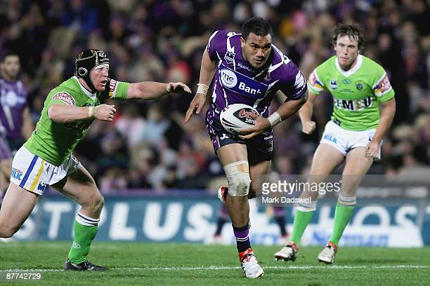 Jeff Lima of the Storm breaks the line of the Raiders defence on his way to scoring a try during the round 10 NRL match between the Melbourne Storm...