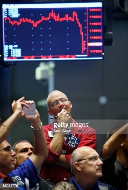 Jeff Linforth stands at the Chicago Board of Trade signal offers in the Standard & Poors stock index futures pit near the open of trading September...