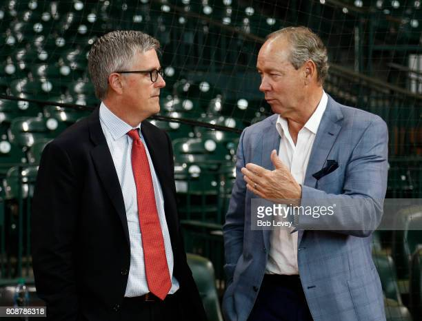 Jeff Luhnow Houston Astros general manager left and Jim Crane Houston Astros majority owner at Minute Maid Park on June 30 2017 in Houston Texas